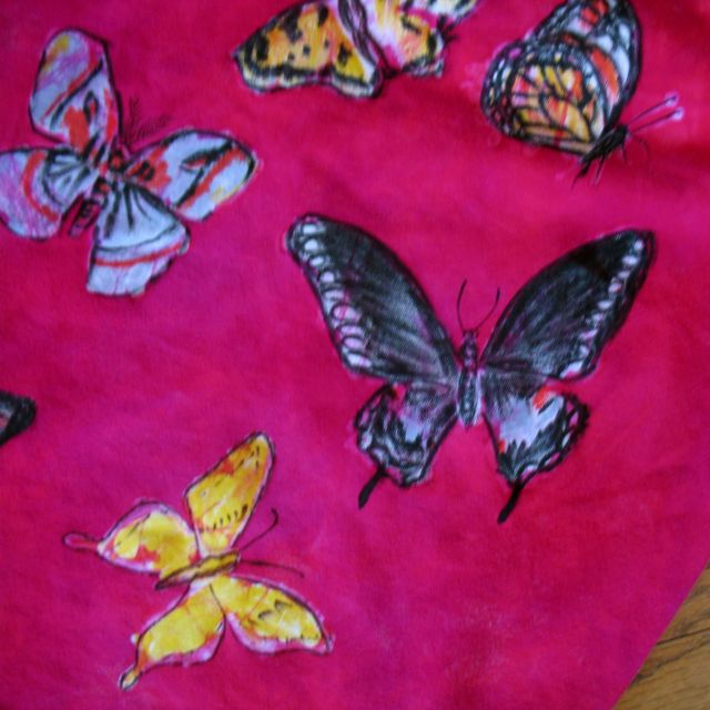 detail of batiked shirt with fabric marker design