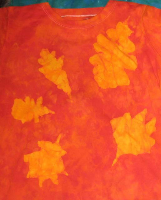 front of orange leaves batik shirt