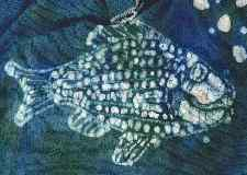 scanned detail of fish batik on cotton knit material